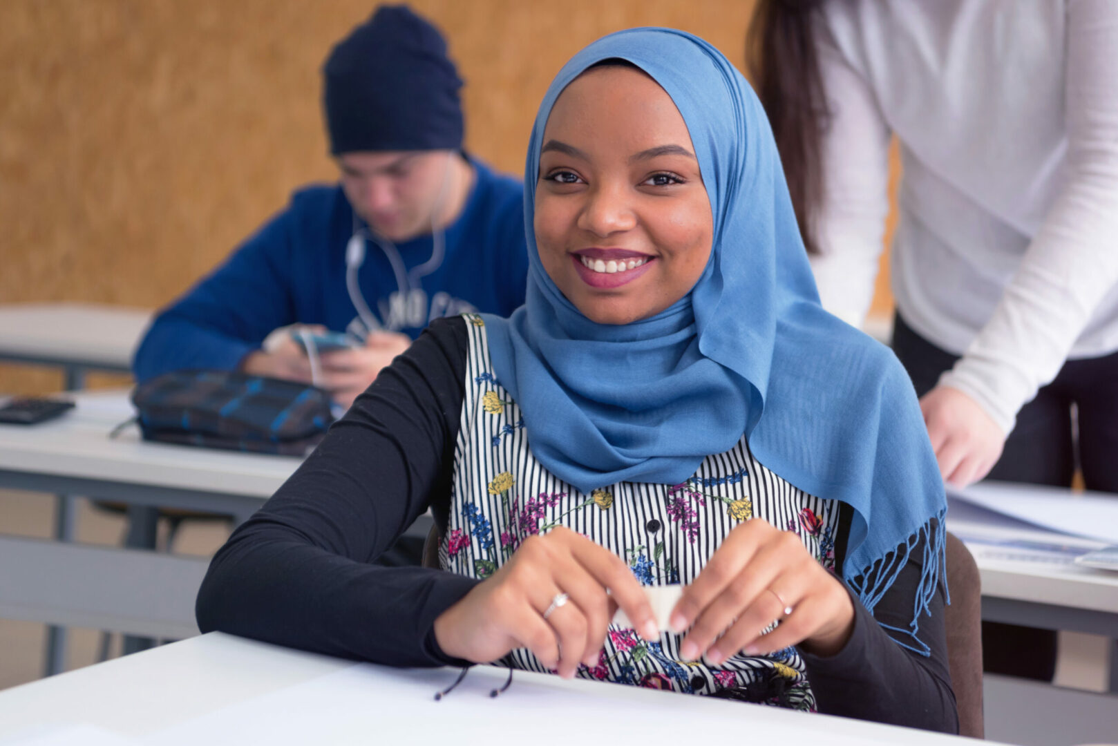 Beautiful female muslim african american architecture student looking and smiling into camera.